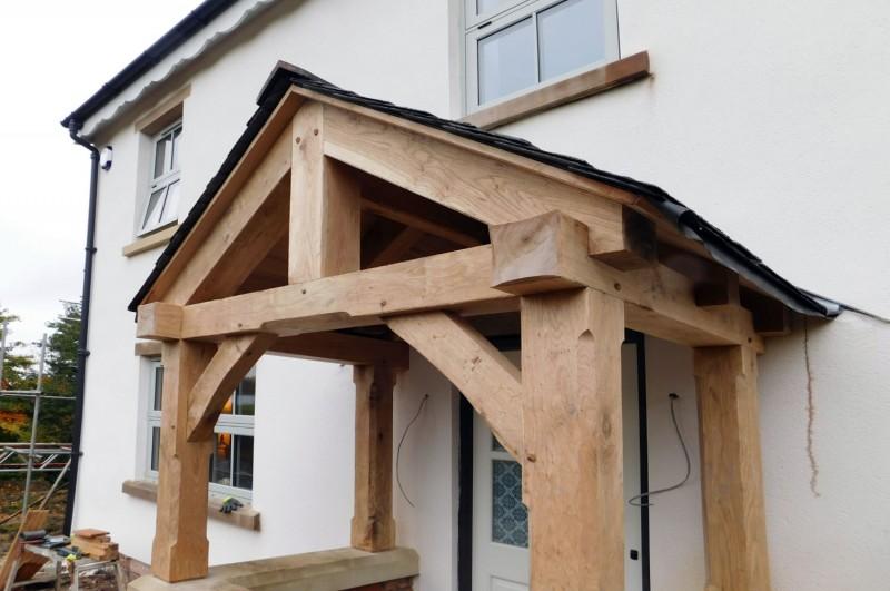 Oak carpentry lancashire english oak timber framed for Timber frame porch addition