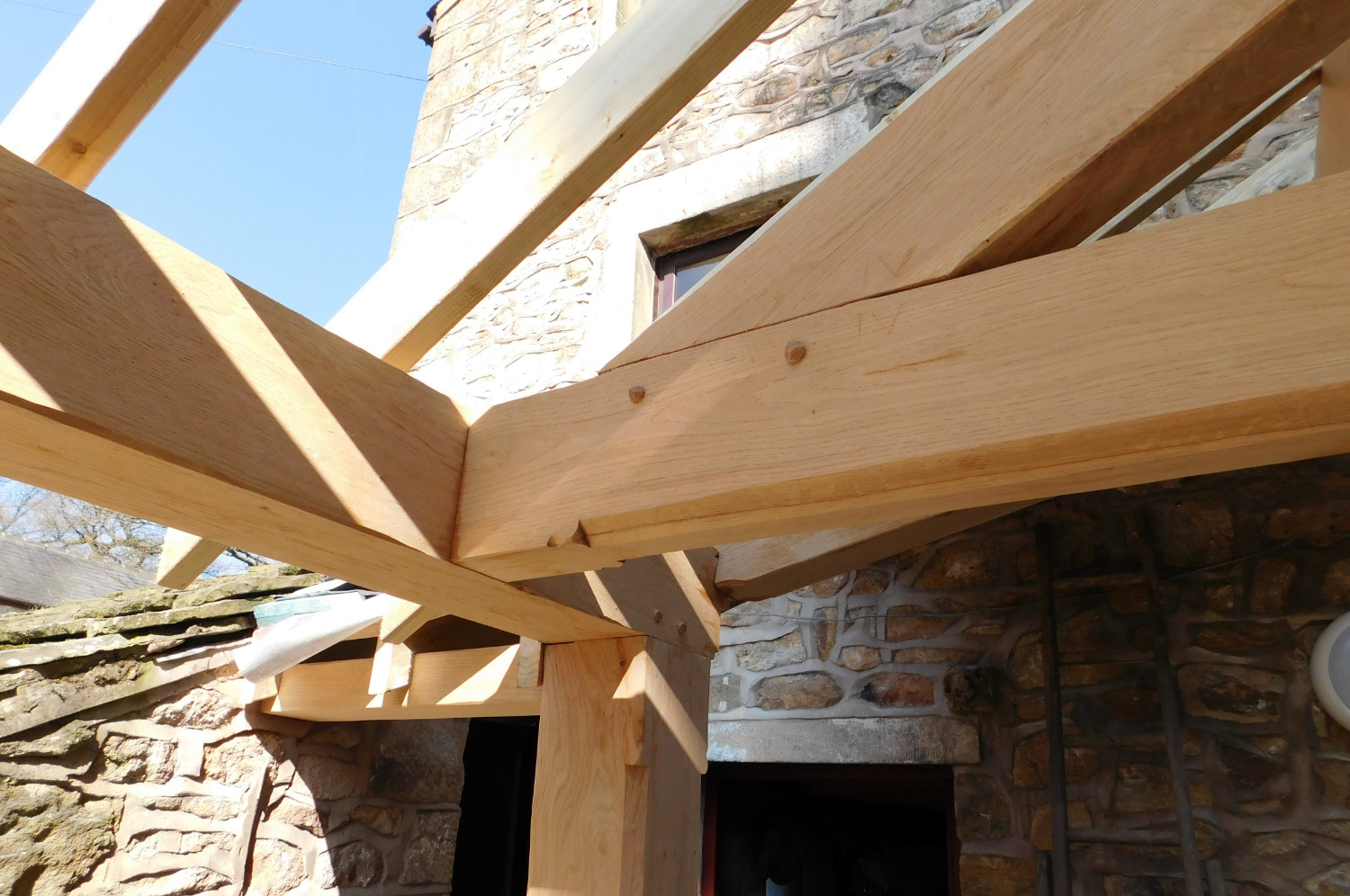 Extension with traditional Oak Frame, stone walls and slate roof