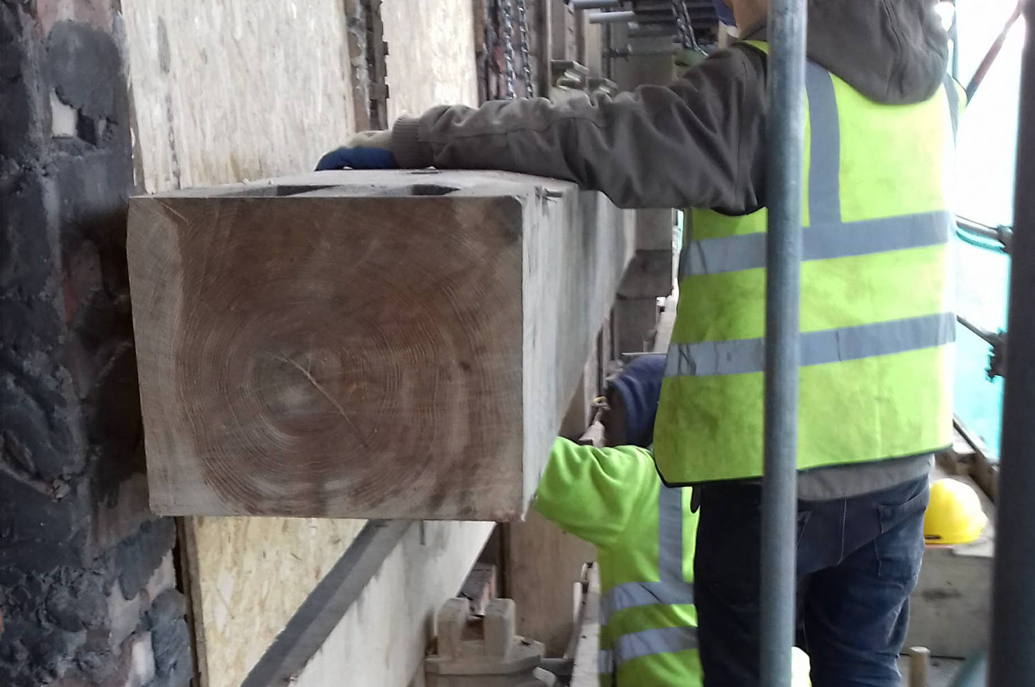 Window cill being hoisted up to locate on three sets of twin tenons, weight is a staggering 500 kg - The Racecourse Hotel, Pub, Salford