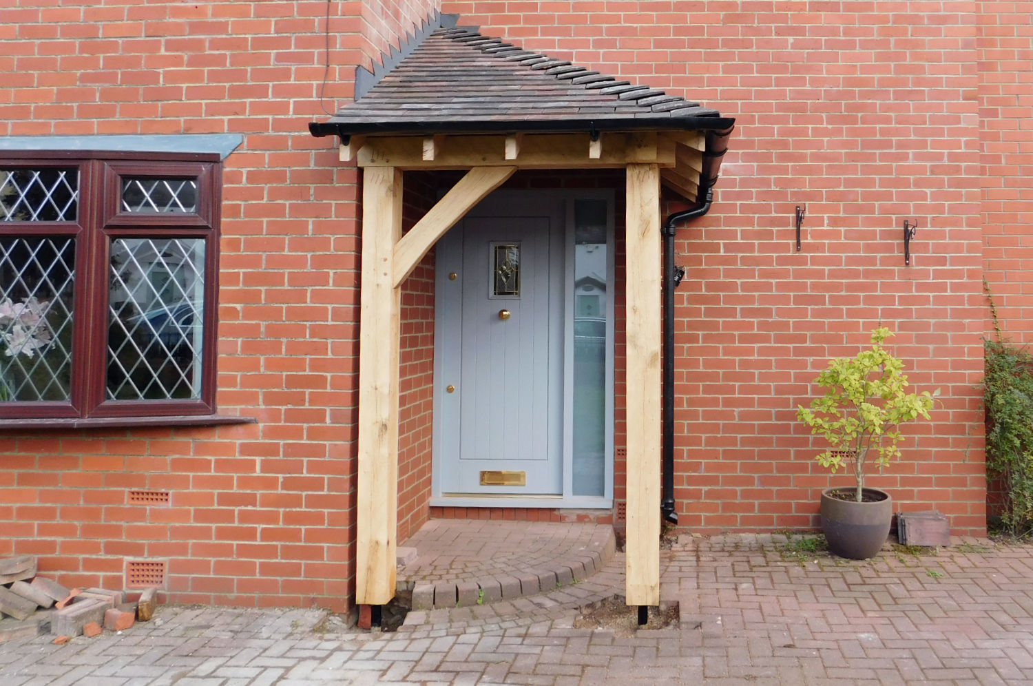 Corner Porch Built Using A Traditional Oak Frame Roof
