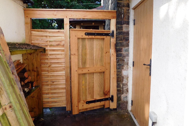 porch, gate, oak frame construction, woven wood side panels, wooden bench, home improvement, bury