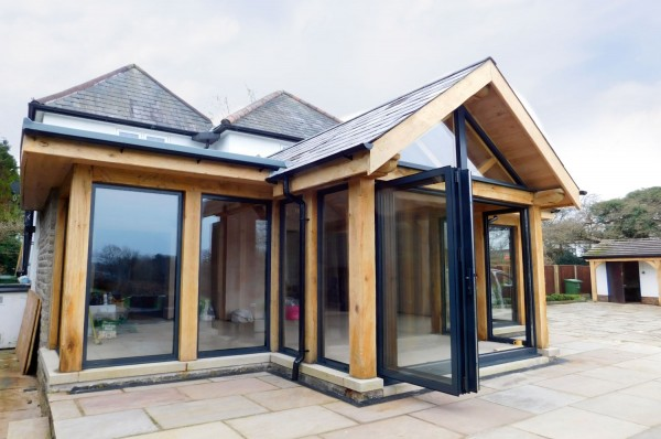 summer room extension, hand finished, oak frame, bi-fold doors, stables, timber, supports