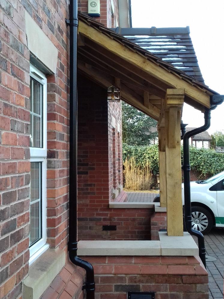 Oak Frame Porch, cast Aluminium rainwater system, truss pediment, recessed doorway, Warrington