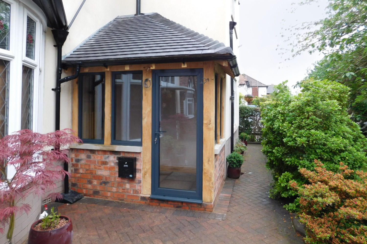 Enclosed Porch, oak frame, dwarf brick wall, hipped roof, aluminium windows, Leigh, Wigan, Oak Carpentry, Lancs, North West