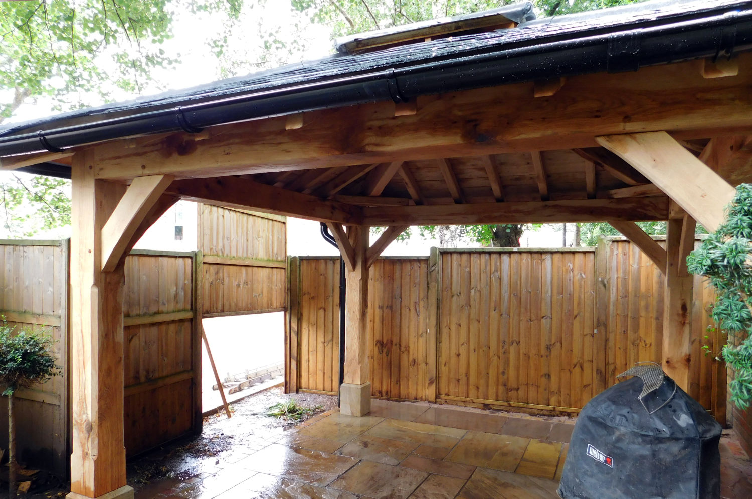 Bespoke oak framed gazebo, canopy for ventilation, slated roof with lead hip roles