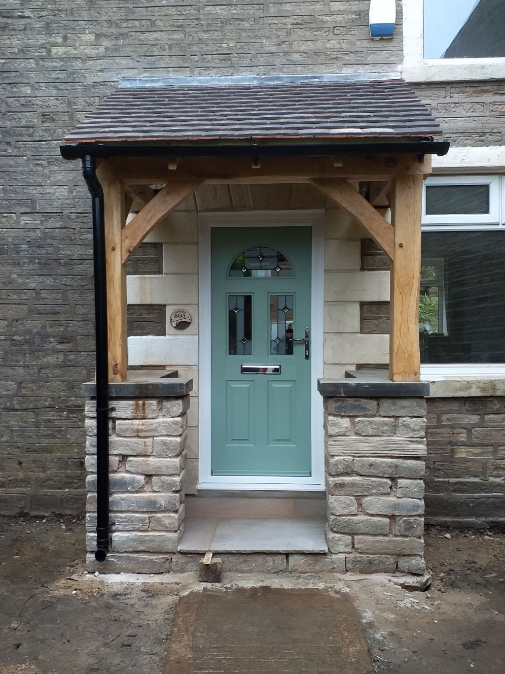 Front entrance, Porch with traditional Oak Frame, stone work, pitched roof complete with rain gutters