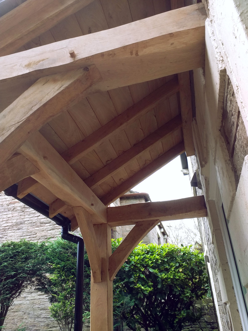 roof detail, Porch with traditional Oak Frame, stone work, pitched roof complete with rain gutters