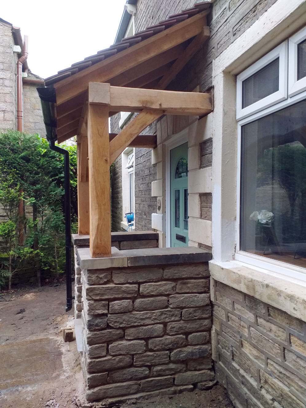side detail, Porch with traditional Oak Frame, stone work, pitched roof complete with rain gutters